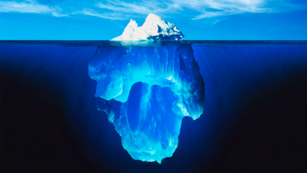 A presentation slide from RealDecoy shows an iceberg to suggest the path to website personalization: businesses are making progress, but it's just the tip of the iceberg.